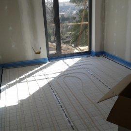 podlahové topení v ložnici